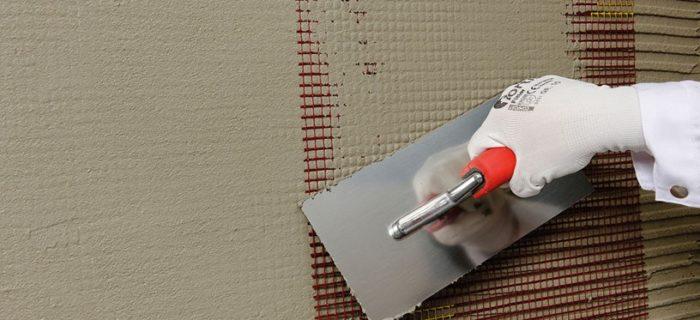 Армирующий слой наносится на утеплитель в слое штукатурки